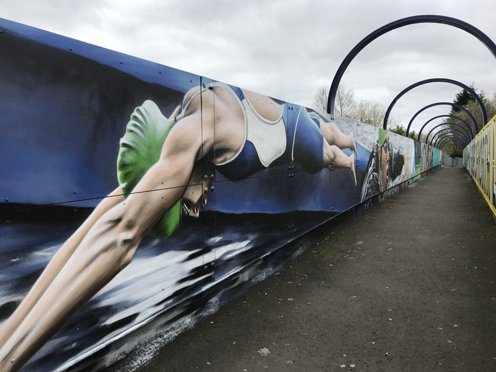 Swimmer street art bridge