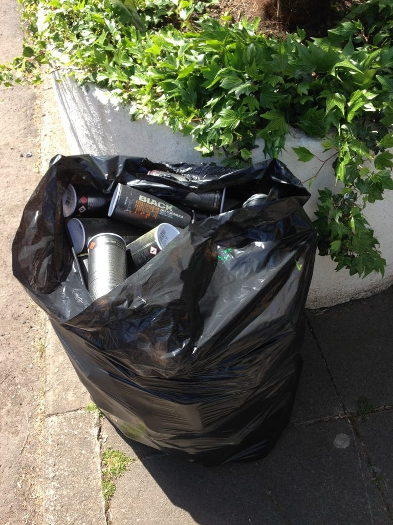 Bag of empty spray paint cans