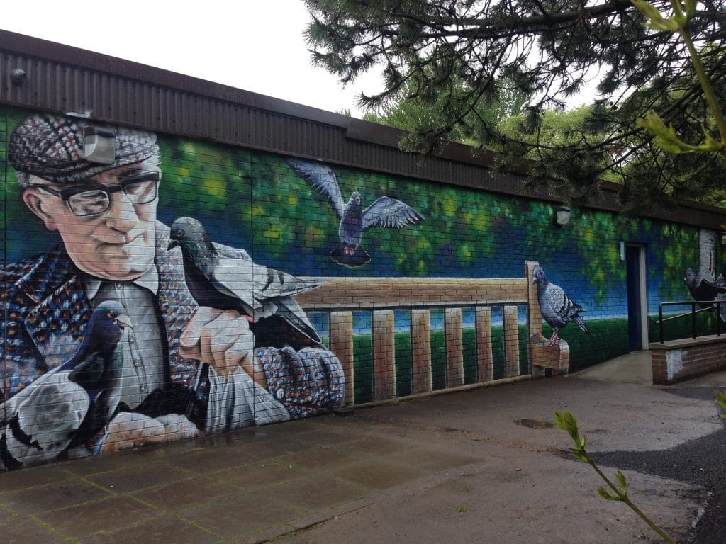 Man with pigeons mural