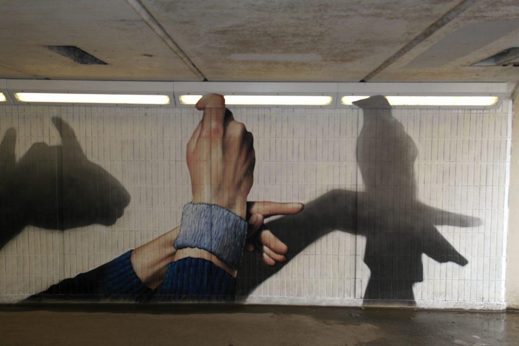 Bird shadow puppet mural