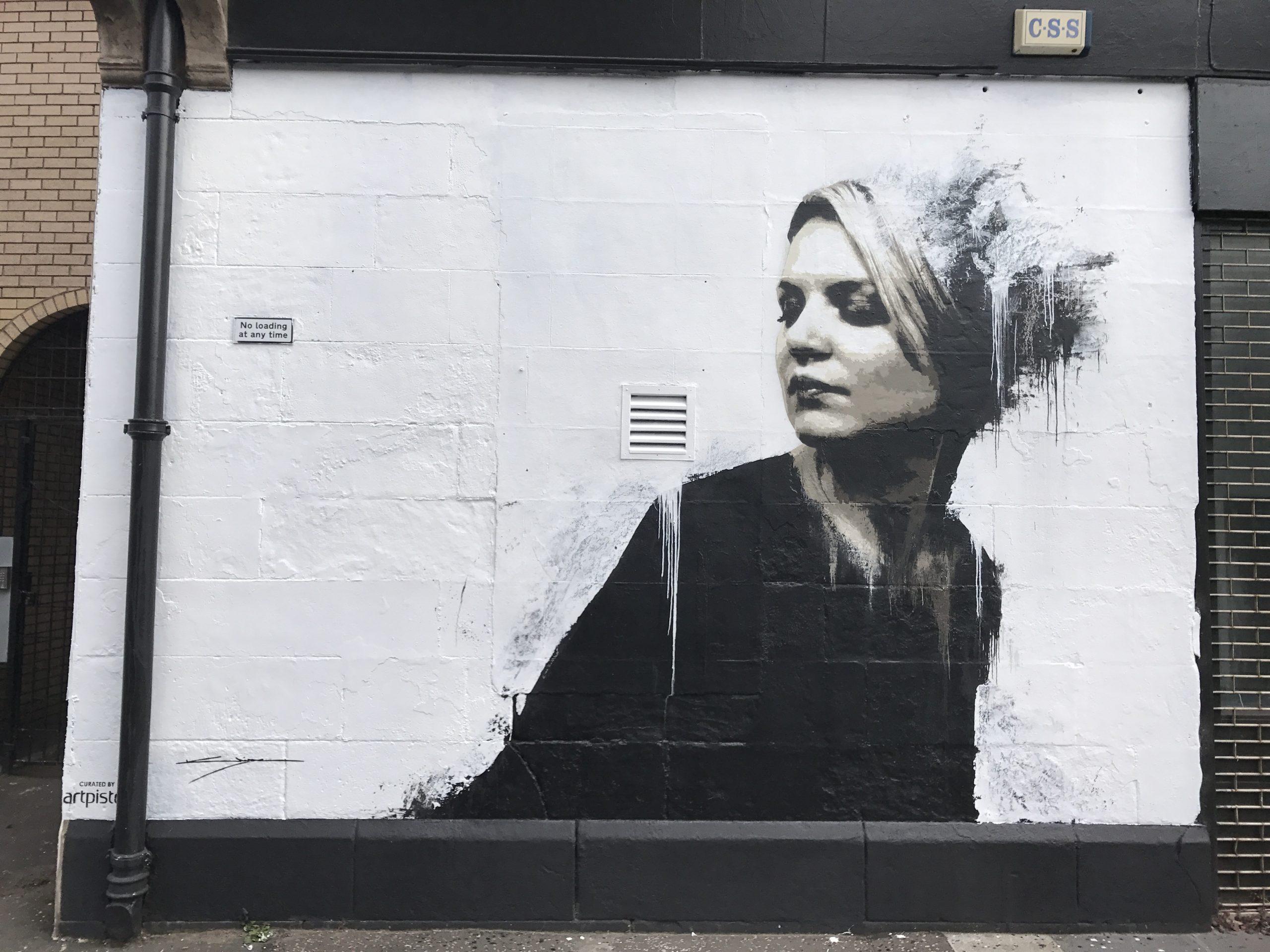 Woman in black mural Bridgegate Glasgow
