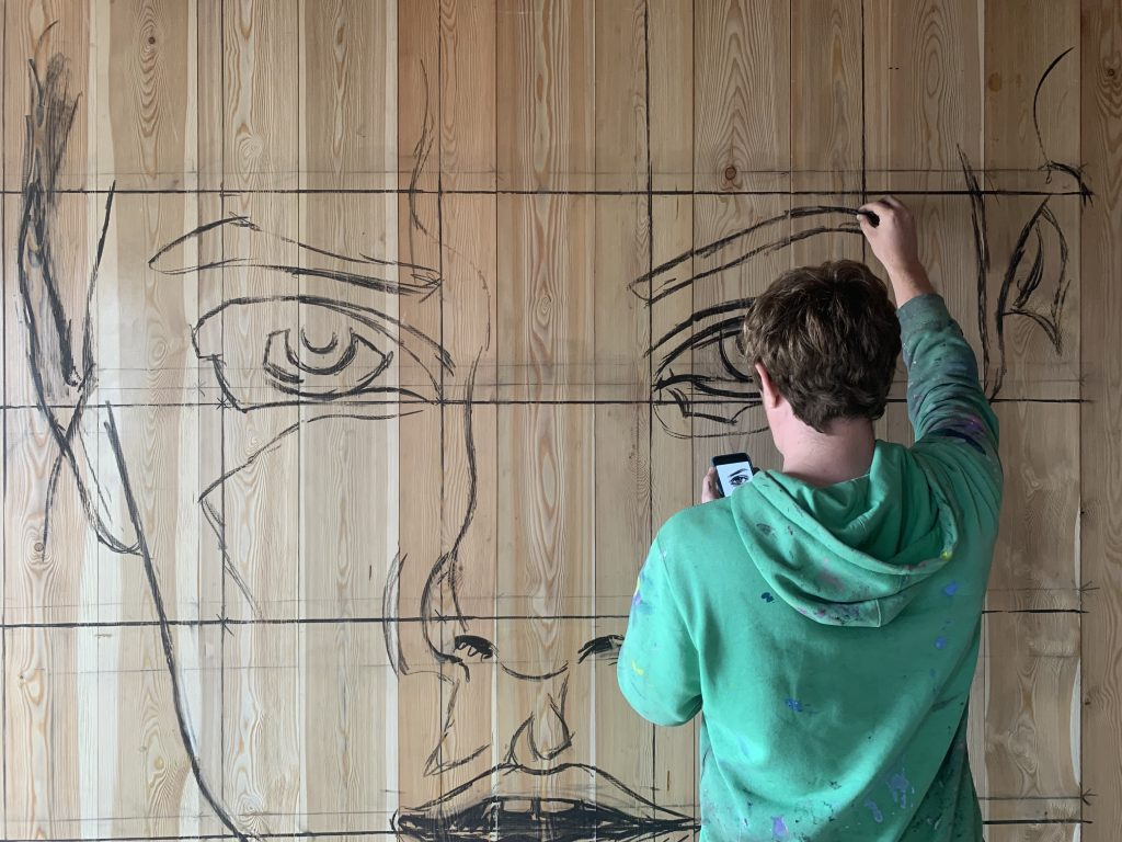 marking up face mural