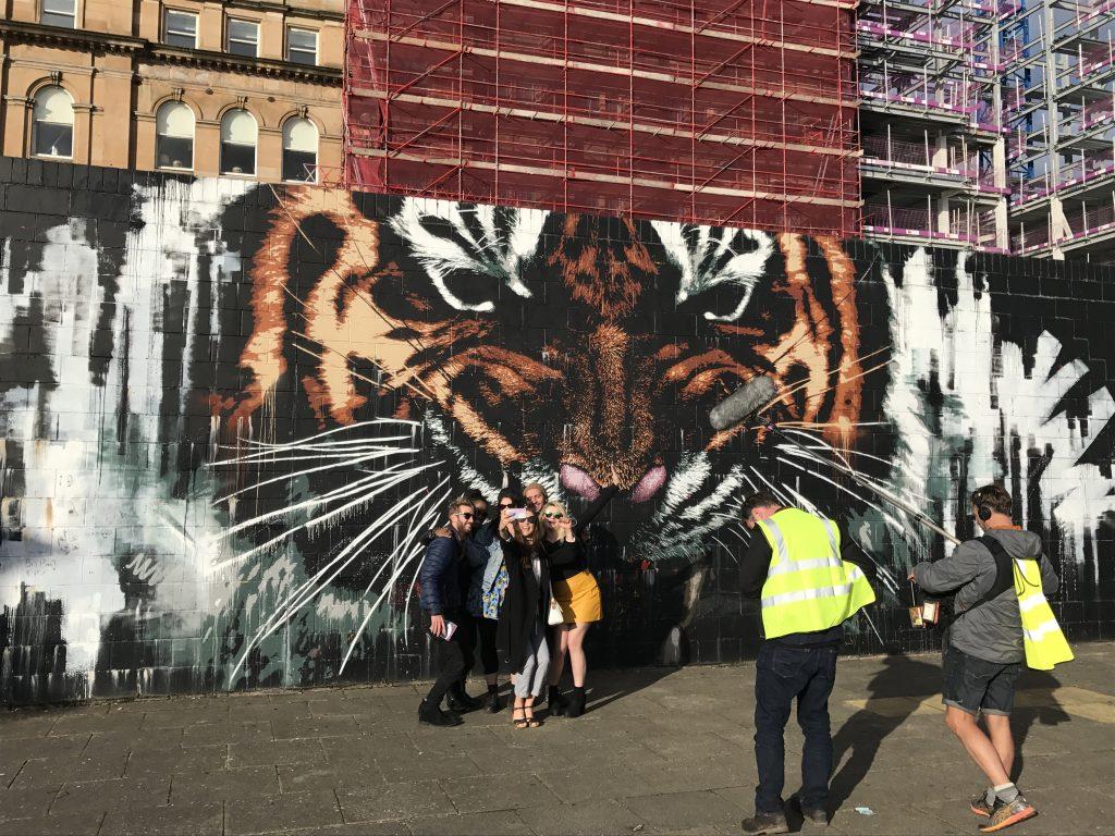 Tiger mural selflies and fliming