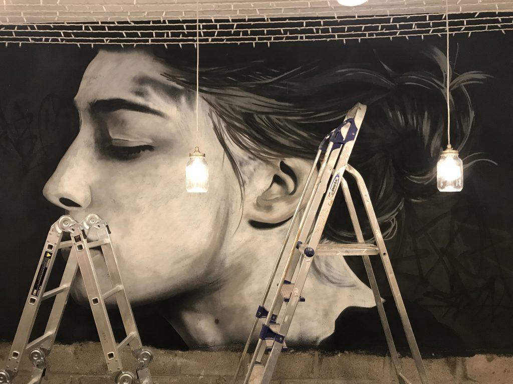 female portrait in progress spray paint