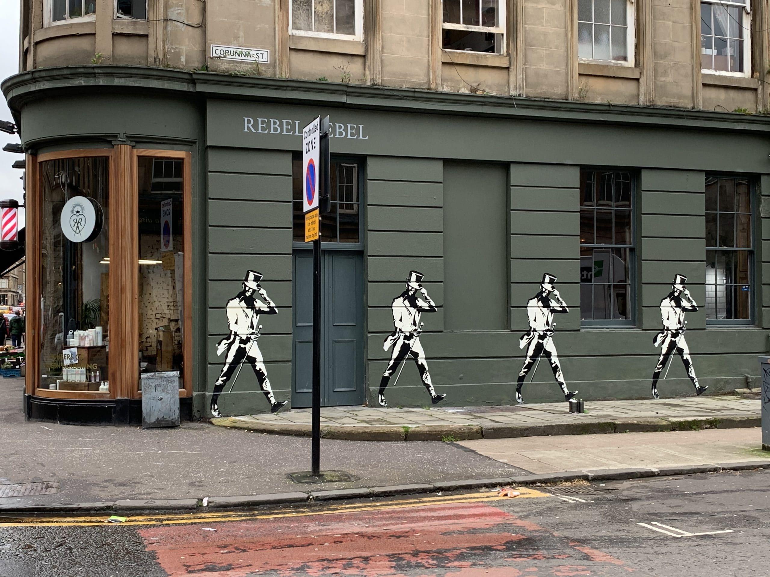 Striding men mural Finnieston Glasgow