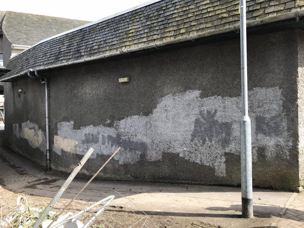 vandalised wall