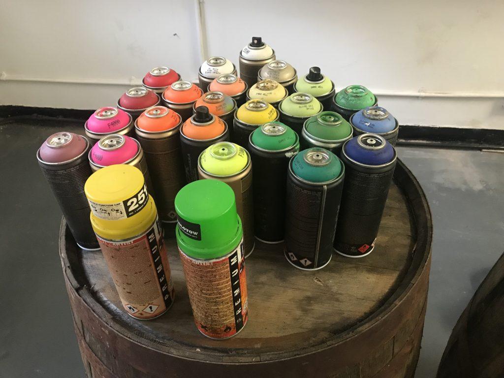 neon spray paint on whisky cask