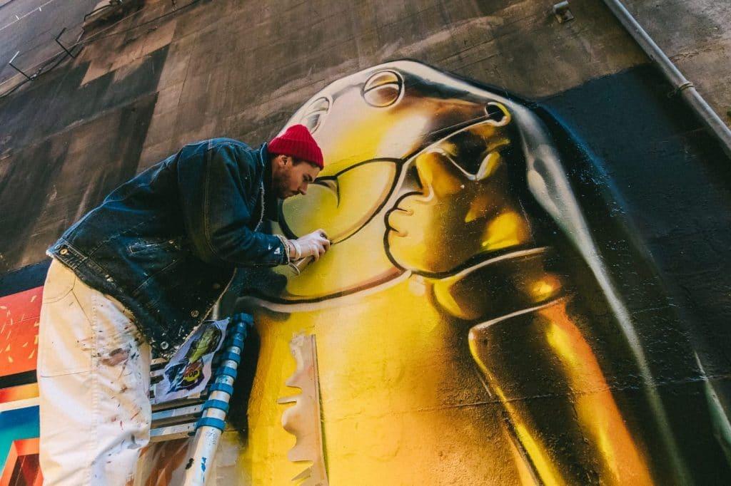 spraying freddo mural